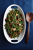 Sherried Green Beans and Mushrooms in a Serving Bowl; Wooden Serving Spoon