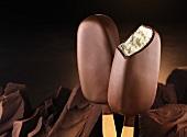 Chocolate-covered vanilla ice cream sticks and pieces of chocolate
