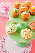 A selection of cupcakes on a cake stand