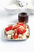 Tomatoes with tofu, soy beans and sesame seeds