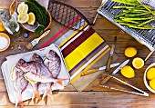Snapper and green asparagus with ingredients, for barbecuing