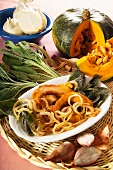 Fried pumpkin wedges, onion rings and sage