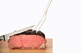 Roast beef with a pepper and herb crust