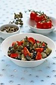 Aubergine salad with olives, tomatoes and capers