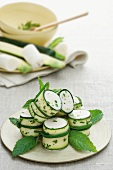 Cucumber rolls with cream cheese and mint