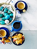 Loukoumades with figs and syrup, brightly coloured eggs for Easter, and coffee (Greece)