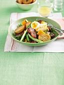 A salad of bread, chorizo, squash, asparagus and a soft-boiled egg