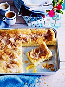 Filo pastry bake with vanilla custard and lemon syrup for Easter (Greece)