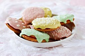 Easter biscuits topped with icing and sugar sprinkles