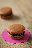 A Chocolate Macaroon on a Small Pink Doily