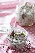 Small Jar of Potato Salad; Larger Jar of Potato Salad in Background