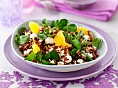 Red rice salad with feta, oranges and bittercress