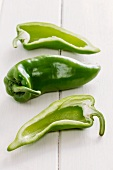 Green pointed peppers, whole and halved