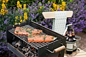 Marinated salmon fillets on a grill (Sweden)
