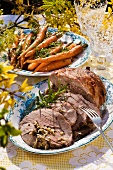 Stuffed roast lamb and glazed carrots on an Easter buffet (Sweden)