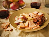 Slices of Aged Gouda, Apple Slices, Figs and Crackers; With Red Wine