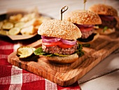 Hamburgers on Sesame Seed Buns on a Wooden Platter