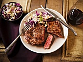 Grass Fed Rib-Eye Steak with Slaw and Red Wine; On a Plate; From Above