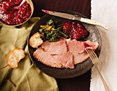 Plate with Slices of Baked Ham, Broccoli Rabe, Cranberry Sauce and Bread; From Above