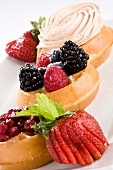 Three Mini Belgian Waffles with Fresh Fruit; One with Cinnamon Frosting