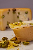 Crostini topped with pecorino and pistachios
