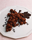 Truffle pralines in the shape of a bunch of grapes