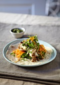 Tortilla topped with lentils, carrots, shiitake mushroom and oranges