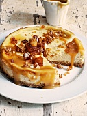 Cheesecake with salted caramel sauce and macadamia nuts