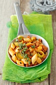 Gnocchi with pork, leek and tomato sauce