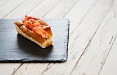 A Single Lobster Roll on Slate