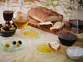 Bread and Dipping Oil; Olives, Red Wine, Oil and Vinegar