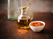 Small Carafe of Olive Oil and a Bowl of Dry Spice Mix