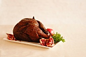 Whole Smoked Turkey on a Platter with Pomegranate
