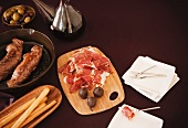 Spanish Meal of Jamon Iberico, Breadsticks, Olives and Chocolate Covered Figs with Red Wine