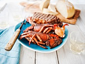 Surf and Turf Platter with Lobster and Steak; Bread in the Background