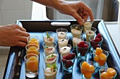 Mini dessert glasses on a tray in French restaurant La Table des Cordeliers run by Michelin starred chef Eric Sampietro