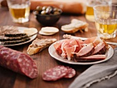 Charcuterie Board with Bread and White Wine
