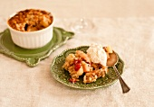 A Serving of Apple Cranberry Cobbler with Ice Cream on a Small Green Plate
