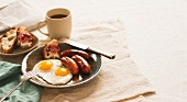 Breakfast Plate with Fried Eggs, Sausage and Bread with Jam; Cup of Coffee