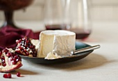 Brie with Pomegranate; Some Brie on a Knife