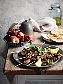 Beef kebabs with coriander on a rustic table