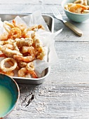Fish strips, prawns and squid rings in batter