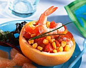 A stuffed grapefruit with sweetcorn, prawns and tomatoes