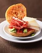 Raw ham and cheese on bruschetta