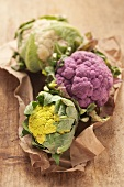 A trio of cauliflowers: white, purple and green