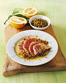 Tuna fillet with an onion and pepper sauce