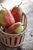 Three pears in a wooden basket