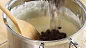 Chocolate fudge being made: chocolate chips being added to a marshmallow mixture