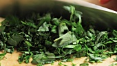 Fresh herbs being chopped