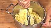 Mashing Potatoes in a Pot